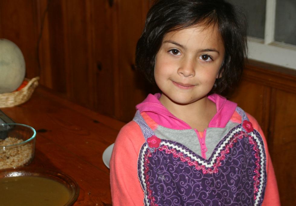 After carefully washing her hands Sabrina put on her favorite apron.