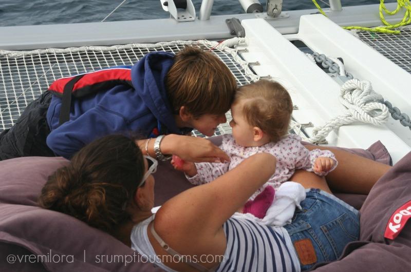 Siblings playing at sea