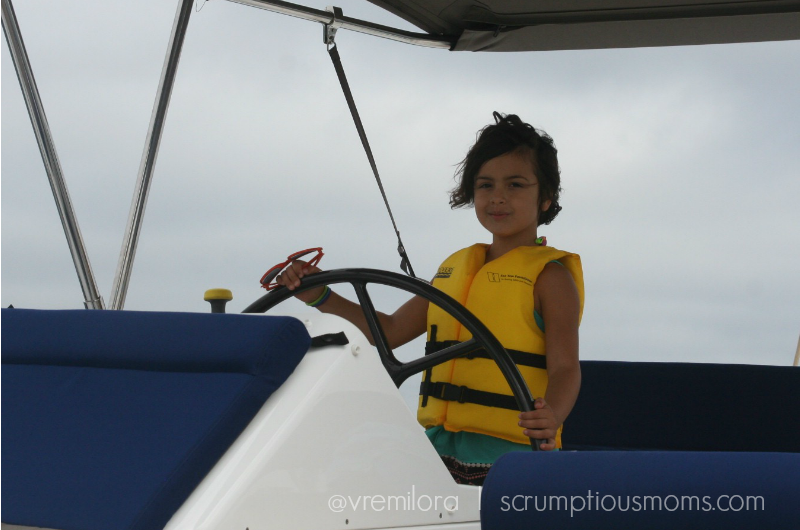 Young Girl steering boat
