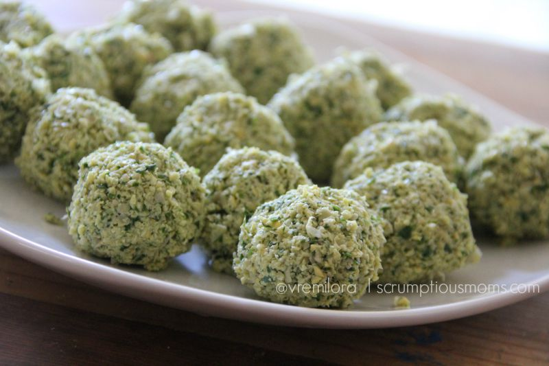 plate of raw falafel balls ready  to  be cooked