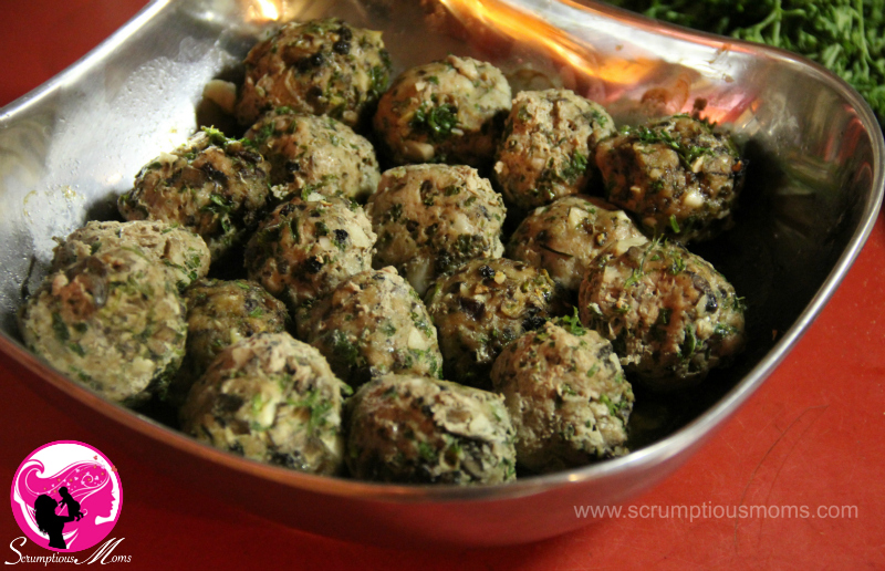 Cooked garlic and mushroom meatballs in serving dish