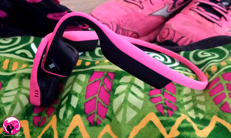 Pink Aftershokz Headphones with gym gear